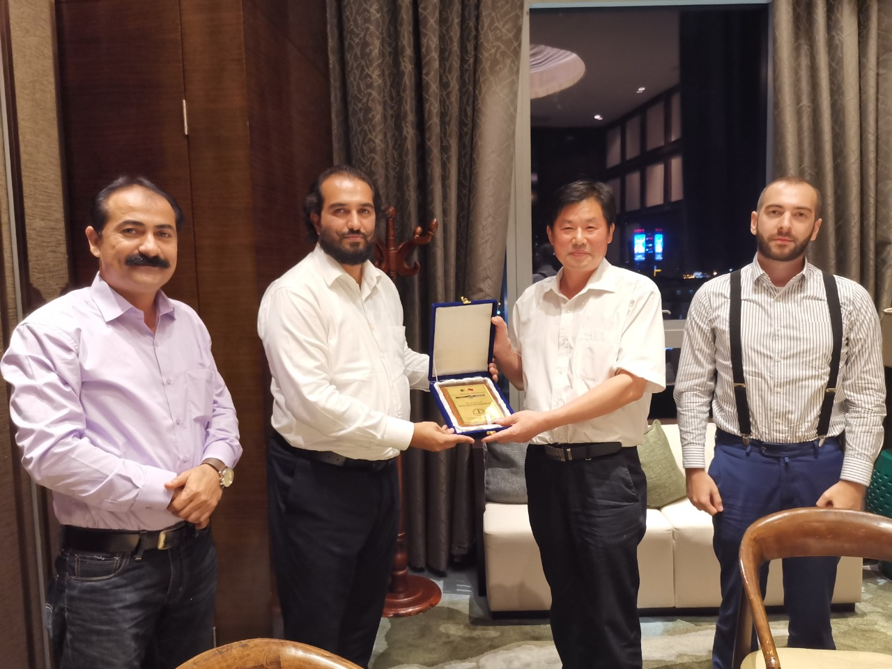 Mr. Nawabzada Zaheer Barakzai - Chairman Mega Movers Pakistan Presenting souvenir to Mr Lu Lin.